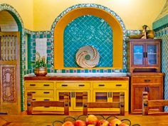 Sarah Leedy-Dooley, ASID, NKBA, used bright yellow walls and an intricate arrangement of hand-painted Mexican Talavera tiles in this kitchen on a large Texas ranch. When choosing strong colors, be sure to check them in situ before buying, so you can see how they appear in the room at various times of the day as the light shifts.