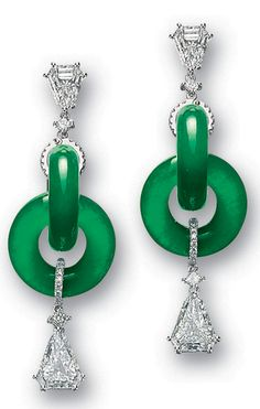 *RARE PAIR OF JADEITE 'DOUBLE HOOP' AND DIAMOND PENDENT EARRINGS Each set with highly translucent interlocking jadeite hoops of emerald green colour, surmounted and anchored by a shield-shaped diamond, joined by princess-cut diamonds and brilliant-cut diamond-set rings, the diamonds altogether weighing approximately 5.75 carats, mounted in 18 karat white gold.