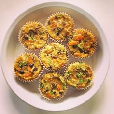 Mini crustless quiches - chop up and stir-fry onions and peppers. Beat a carton of egg whites and 6 full eggs in a large bowl. Add veggies and I also added black beans & quinoa for sustenance. Once everything is ready, mix all the ingredients together and put in a muffin tin lined with parchment muffin cups, this way they don't stick and no oil is needed. I've been heating them up in the mornings and they are very filling. #healthfoodsnob
