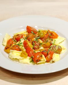 Ricotta Raviolini with Melted Tomatoes - Fresh pasta filled with ricotta & Parmigiano - Reggiano makes for a comforting but classy meal in this recipe from chef Scott Conant.