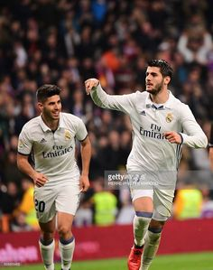 Real Madrid's forward Alvaro Morata (R) celebrates with Real Madrid's midfielder Marco Asensio after scoring during the Spanish league football match Real Madrid CF vs RC Deportivo at the Santiago Bernabeu stadium in Madrid on December 10, 2016. / AFP / PIERRE