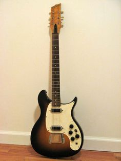 early Magantone deasined by Paul Barth, before he designed the Rickenbacker Capri