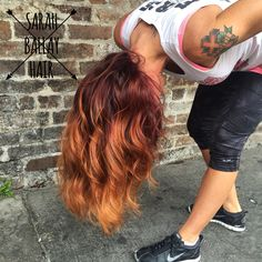 Red ombré melting into copper with balayage blonde highlights. Fire inspiration