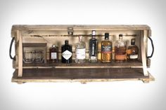 Made from repurposed wooden ammunition boxes, the Bomb Bar is a novel way to store your liquor stash in plain sight. While the exterior is purposefully rough, the interior features handsome walnut lining, with leather straps holding the lid at. Crate Bar, Liquor Storage, Walnut Shelves, Diy Bar Cart, Ammo Cans, Home Projects, Pallet Projects, Liquor Cabinet, Repurposed