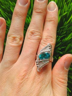 Sparkle princess wire wrap ring! Like a tiny sparkly spaceship resting on your finger! This listing is for a radiant faceted teal topaz ring