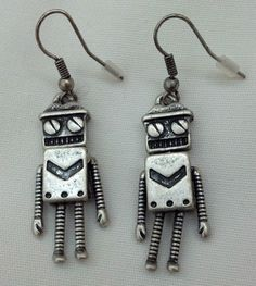 http://www.ebay.co.uk/itm/NEW-nickel-free-silver-plated-ROBOT-hook-earrings-w-movable-parts-VALENTINES-/181071202918?pt=UK_JewelleryWatches_WomensJewellery_Rings_SR=item2a28af4a66
