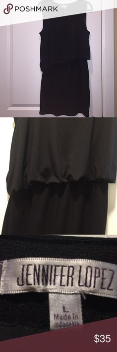 JENNIFER LOOEZ mini dress Black mini dress with loose fitting too and right skirt. Super cute on! Jennifer Lopez Dresses Mini