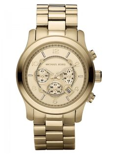 Michael Kors Runway Silver-Tone Stainless Steel Chronograph watch features fixed stainless steel bezel, silver dial with luminous hands and alternating stick and Arabic numeral hour markers.