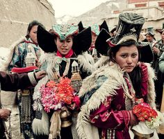 """Tibetan women with full regalia.  The middle women wears a fabolous """"Perag"""" (felt headdress with lots of turquoise and other stones)."""