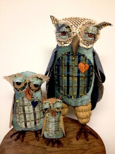 Pictured with Gretchen and Timmy Victor, their dad is 13 inches tall. Hand stitched, made of upholstery fabric and stuffed with a combination of feathers and fiberfill. Their claws are galvanized steel wire coated with floral tape made just for them. They're free standing.