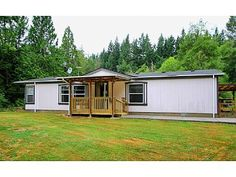 This property features a lovely 3 bedroom, 2 bath mobile home with a detached shop on 7+ acres surrounded by tall trees and lush greenery. All appliances and free standing wood stove included! Property has limitless potential for someone wanting to build their dream home. Located adjacent to Cedar River Trail and within award winning Tahoma School District.