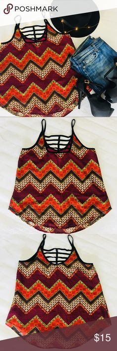 BCX Spaghetti Strap Blouse Chevron Boho - Size L BCX Spaghetti Strap Tank Top Blouse with Chevron, India Inspired Pattern/Floral - Size Medium   Good Used Condition! Sheer Patterned Layer over built in Maroon Lining. Black Edge Detail.   Approximate Measurements-   Across the Chest: 17.5 inches  Shoulder to Hem: 25 inches (Longer at Mid then Side)  P022 BCX Tops Tank Tops