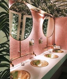 The ultimate bathroom. Palm tree and pink tiling combo finished with gold accents.