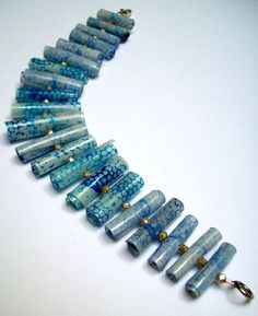 Would you believe these beads are recycled plastic bottles? In other photos there are hints on how to make your own.
