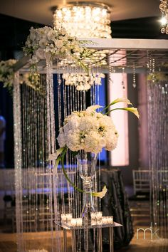 Beautiful Blooms MK Photography Crystal Chuppah White Flowers Tendenza White Tall Centerpieces Calla Lilies