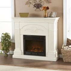 Easily add charm, elegance, and warmth with this classically styled electric fireplace. It plugs into a normal electrical outlet and uses the same amount of energy as a normal coffee maker. You can adjust the thermostat and the flame brightness. Fake Fireplace, Fireplace Ideas, My Living Room, My Dream Home, Family Room, Sweet Home, New Homes, Home And Garden, Indoor Fireplaces