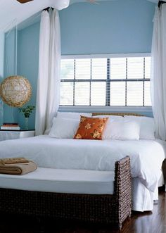 gorgeous casual bedroom. window behind bed