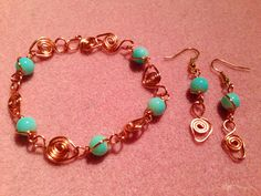 """Copper wire wrapped bracelet & earrings with pale blue glass beads.  """"Made By Kayleigh""""  https://m.facebook.com/JulesLittleGems2011"""