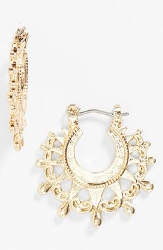 These shiny gold hoop earrings are so cute.