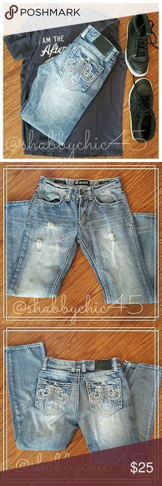 """CJ Black Rue 21 Fleur-de-lis Distressed Jeans Like New Rue 21!! Manufacturer distressed decorative rear pocket jeans. These jeans have the designer look without the designer price tag! Trendy distressed style in stone washed denim. No stains or """"unitended"""" rips or tears! Hems are intact with no fraying. Slim straight style. 29 waist with 30 inseam. PRICE IS FIRM.    ??Smoke free home. No trades. Open to reasonable offers unless marked as firm.? Happy Poshing!! ?? Rue 21 Jeans Straight"""