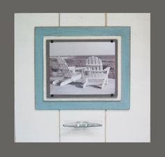 Transform your wall space into an artful focal point with this nautical large white cleat frame! This frame is displayed with white planks a...
