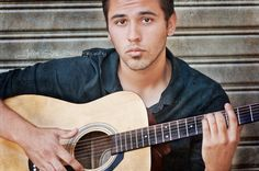 senior male photo session with guitar in hand
