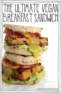 The Ultimate Vegan Breakfast Sandwich! Thick slices of smoky, marinated tofu on an English muffin with mashed avocado, a slice of ripe tomato, and a homemade 5-minute vegan egg yolk inspired sauce. The tofu gets more flavourful the longer it marinates. I just keep it marinating in the fridge, so when morning hunger strikes, it's game on! #itdoesnttastelikechicken #veganrecipes #veganbreakfast #eggfree via @bonappetegan