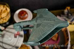 Use fishing line to hang a Romulan Warbird over the food table at your Star Trek: The Next Generation party
