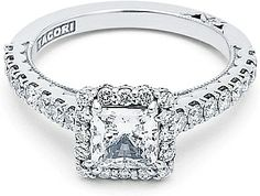 Tacori Blooming Princess Cut Halo Diamond Engagement Ring  : Handcrafted in California, 0.73 carats of round stones are set along the band of this French cut style setting with a square shaped bloom adorning your choice of a princess-cut diamond at the center. A signature Tacori crescent adds the finishing touch on the band.