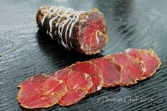 Bresaola or beef bresaola is one of the cured meat cold cut or charcuterie. Bresaola, sometimes called brisaola is air-dried, salted and spiced beef, bison or venison deer that has been aged for se. Jerky Recipes, Meat Recipes, Wine Recipes, Cooking Recipes, Sushi Recipes, Charcuterie Recipes, Cuisines Diy, Spiced Beef, How To Make Sausage