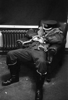London. A station commander sleeps briefly while awaiting the return of his night bomber crews. Life in London during The Blitz of World War II in 1939-40. 1940.