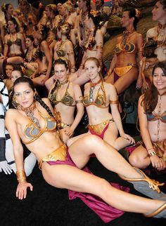 So many princesses to save, so little time. Slave Leia(s) cosplay.