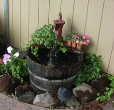 water fountain made from an old oak barrel and an antique pump . . . how clever!
