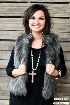 Snuggle Up In Style Faux Fur Vest in Black $49.95 www.gugonline.com