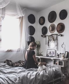 Pallet bed and cinder block cement block desk / vanity. Hats and jewelry as art. Sheer white window drapes and dream catchers, fur throw.  Lovely wabi sabi mix of rough/fine.