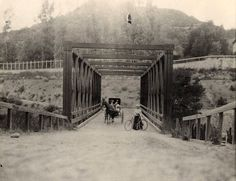 The Scoville Bridge, seen here in traversed the stream of the Arroyo Seco but still required travelers to descend into the ravine and then climb the opposite bank after crossing. Courtesy of the Pasadena Museum of History. San Gabriel Mountains, San Gabriel Valley, Pasadena California, Vintage California, Southern California, Colorado Street Bridge, Old Bridges, San Luis Obispo County, California History