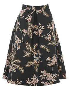 Our favourite full shape midi skirt is back, and we're more than happy to welcome this oriental print version into our wardrobes. Made from a luxe-feel thick fabric covered in a pretty oriental print floral pattern, this A line midi skirt features an exposed zip fastening to the reverse and flattering pleating to create a sweet and girly silhouette.