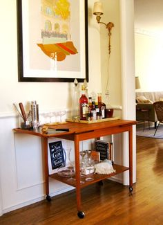 bar cart in dining room? (perhaps combined with hidden cabinet above?) This one is beautiful.  //  10 Ideas For Setting Up A Home Bar - Celebrations at Home