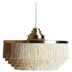 Silk Fringe Brass Pendant Lamp by Hans-Agne Jakobsson | From a unique collection of antique and modern chandeliers and pendants at https://www.1stdibs.com/furniture/lighting/chandeliers-pendant-lights/