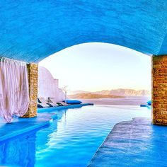 This serene pool is part of Astarte Suites Hotel in Santorini, Greece. Could you imagine?  Source: Instagram user parci1
