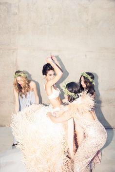 Bridal dressing 101: bridesmaids' assistance necessary.