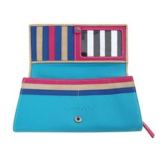 Playful yet refined. The nude suede front of this wallet opens up to a rainbow of colors and contrasting black and white striped pockets. Flip it over to find beautiful turquoise leather. Click to see more views. Marimekko Helinä 2 Beige/Turquoise Leather Wallet.