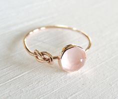 Rose Quartz Ring, Rose Gold Ring, Infinity Knot Ring, Symbol Ring, Friendship Gold Ring, Yellow Gold Ring, Stack Ring, White Gold Ring I made this ring from 14k recycled Gold and set a 6mm rose-cut Rose Quartz into it. The ring band is hand wrung into an infinity symbol, a symbol made for friendship, life and everything else there is for you forever. This sparkly blush pink Rose Quartz lets light shine through and is so very feminine! I can make this ring in 14k Rose Gold or 14k Yellow…