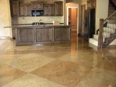 Stained Concrete in Kitchen and Den possibility. Also, check out the stained concrete that looks like true hardwood floors!