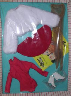 Vintage Barbie Ice Breaker #942 (1962-1964)    White Fur Jacket  Red Velvet Skirt  Red Knit Body Blouse  Flesh tone Pantyhose  White Ice Skates    Both the jacket and circular skirt of this adorable skating ensemble have a cute calico print lining.