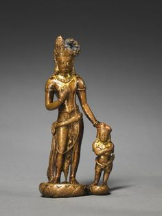 8th century, Nepal, Vajrapani with Vajra Anuchara, gilt copper alloy, at the Cleveland Museum of Art (USA).