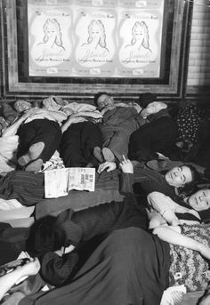 People asleep on the escalators at Piccadilly Tube Station, London, during an air raid, 1940.  <b>From the Victorian era through to World War Two - featuring tube strikes, carriage redesigns, passenger complaints, ticket machines and air raid shelters.</b>