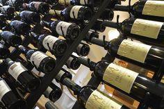 """Ampia selezione di vini pregiati, bologici, biodinamici e trilpe """"A"""". Wine Rack, Bar, Storage, Home Decor, Purse Storage, Decoration Home, Room Decor, Larger, Wine Racks"""