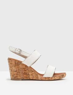 Perfect for strolling on sunny days, these cork wedges look great with cropped jeans. The heel feels sturdy, but these open-toe sandals are delicate enough to pair with your floatiest skirts and summer dresses too. Contrasting piping shows off the vibrant colours and textured fabric.