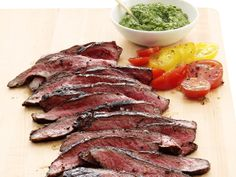 Flank Steak with Salsa Verde from FoodNetwork.com: make Salsa Verde (more like chimichurri sauce) I day ahead for flavors to meld, and also add fresh garlic to salsa verde